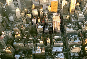 New York's streets and buildings look like a puzzle from atop the 				Empire State Building.